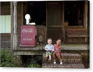 Two Young Children Pose On The Steps Of A Historic Cabin In Rural Alabama Canvas Print