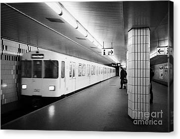 Ubahn Canvas Print - u-bahn train pulling in to ubahn station Berlin Germany by Joe Fox