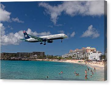 U S Airways Low Approach To St. Maarten Canvas Print by David Gleeson