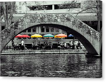 Umbrellas Of Many Colors Canvas Print by John Kain