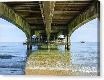 Under A Pier Canvas Print by Svetlana Sewell
