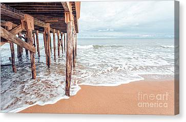 Under The Boardwalk Salsibury Beach Canvas Print by Edward Fielding
