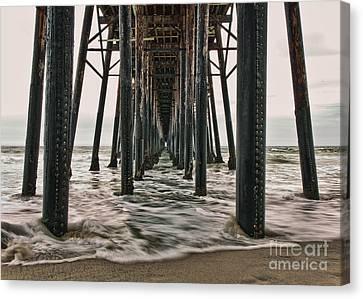 Under The Pier Canvas Print by Eddie Yerkish