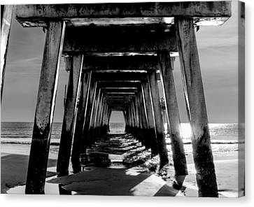 Canvas Print featuring the photograph Under The Pier by Frank Bright
