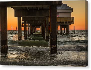 Under The Pier Canvas Print by Jane Luxton