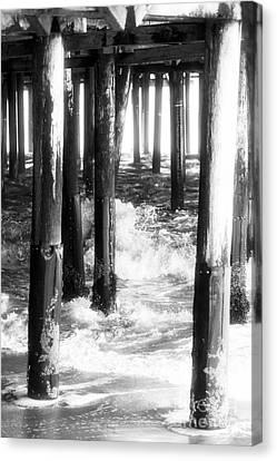 Under The Santa Monica Pier Canvas Print by John Rizzuto