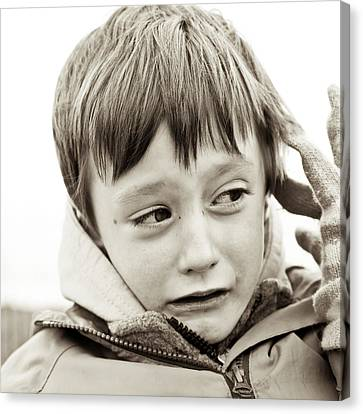 Unhappy Boy Canvas Print by Tom Gowanlock