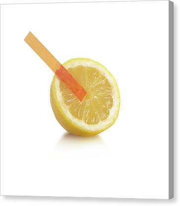 Universal Indicator Test On A Lemon Canvas Print by Science Photo Library