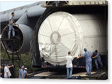 Canvas Print featuring the photograph Unloading A Titan Ivb Rocket by Science Source