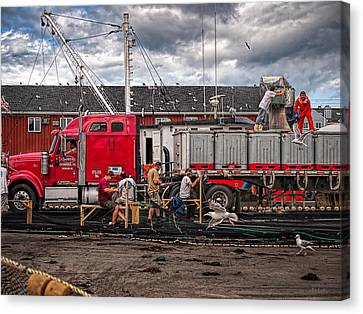 Unloading Fish And Mending Nets Canvas Print by Bob Orsillo