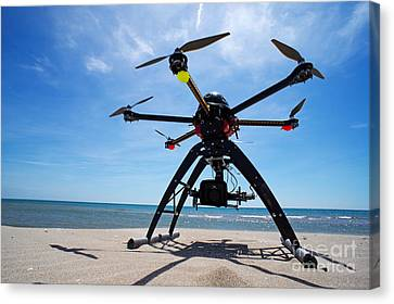 Unmanned Aerial Vehicle On Beach Canvas Print by Sami Sarkis