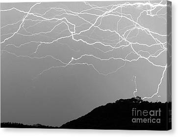 Unreal Lightning In Black And White Canvas Print by Michael Tidwell