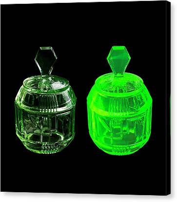Uranium Glass Fluorescing Canvas Print by Science Photo Library