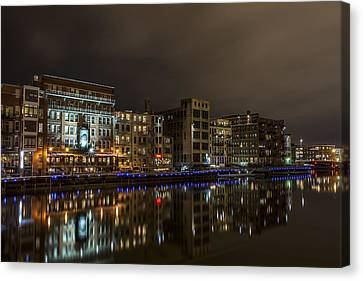 Urban River Reflected Canvas Print by CJ Schmit