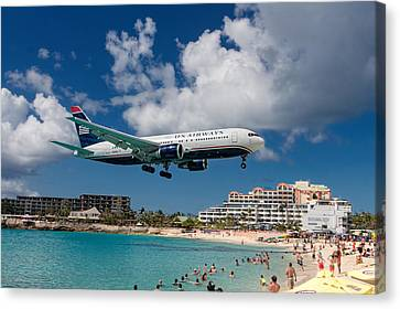U S Airways Landing At St. Maarten Canvas Print by David Gleeson