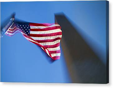 Us Flag At Washington Monument At Dusk Canvas Print