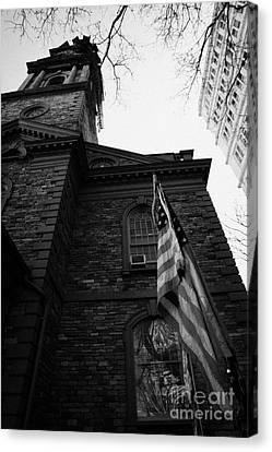 Us Flag Flying Outside St Pauls Chapel Ground Zero New York City Canvas Print by Joe Fox