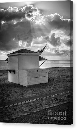 Us Flag On Beach Hut Illuminated By Early Morning Sun - Black And White Canvas Print
