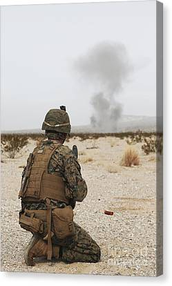 U.s. Marine Provides Security As Part Canvas Print by Stocktrek Images