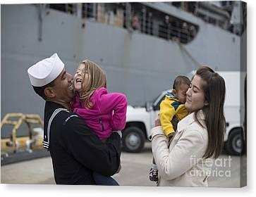 U.s. Navy Sailor Greets His Family Canvas Print