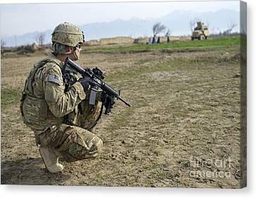 U.s. Soldier Patrols A Village Canvas Print by Stocktrek Images