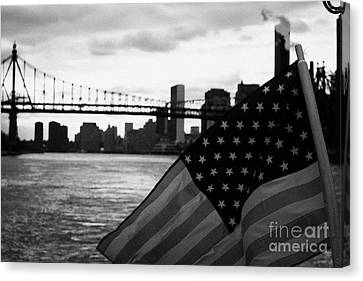 Us Stars And Stripes Flag Fluttering In The Wind East River New York City Canvas Print by Joe Fox