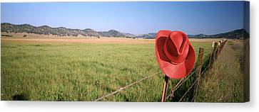 Usa, California, Red Cowboy Hat Hanging Canvas Print by Panoramic Images