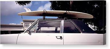 Usa, California, Surf Board On Roof Canvas Print