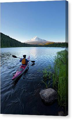 Usa, Oregon A Woman In A Sea Kayak Canvas Print