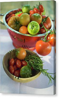 Wooden Bowl Canvas Print - Various Types Of Tomatoes In Wooden Bowl And Colander by Foodcollection