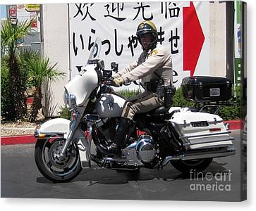 Vegas Motorcycle Cop Canvas Print by John Malone