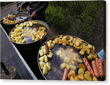 Vendor Selling Deep Fried Potatoes Canvas Print by Panoramic Images