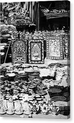Vertical Rows Of Local Speciality Ceramics For Sale To Tourists On A Stall In The Souk Market In Nabeul Tunisia Canvas Print by Joe Fox