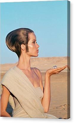 One-shoulder Dress Canvas Print - Veruschka Von Lehndorff Sitting In A Desert by Franco Rubartelli