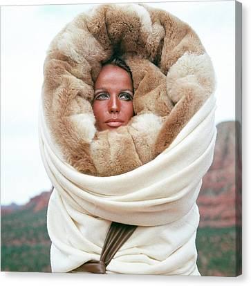 Veruschka Von Lehndorff Wearing A Fur Wrap Canvas Print by Franco Rubartelli