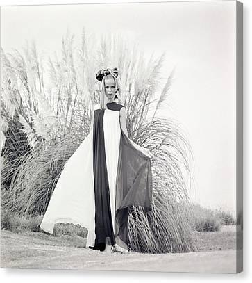 Veruschka Wearing A Teal Traina Dress Canvas Print by Franco Rubartelli