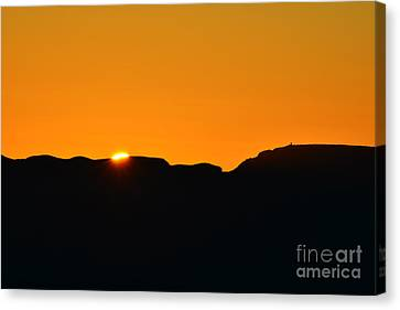 Vibrant Orange Sky Accompanies Sun Rising Over Grand Canyon With Distant Watchtower Silhouetted Canvas Print by Shawn O'Brien