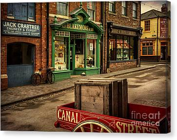 Wagon Wheels Canvas Print - Victorian Town by Adrian Evans