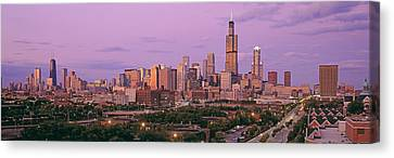 View Of A Cityscape At Twilight Canvas Print by Panoramic Images