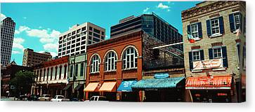 View Of Buildings On 6th Street Canvas Print by Panoramic Images