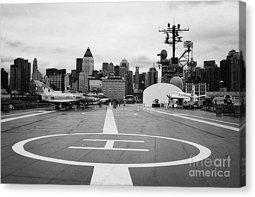 view of manhattan from the rear helicopter pad on the flight deck USS Intrepid  Canvas Print by Joe Fox