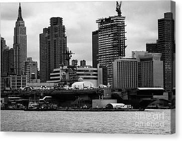 view of manhattan skyline USS Intrepid Aircraft Carrier new york city Canvas Print by Joe Fox