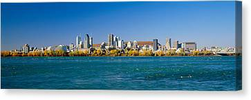 View Of Montreal Skyline And The Saint Canvas Print by Panoramic Images
