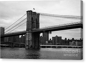 View Of New York From Beneath The Brooklyn Bridge New York City Canvas Print by Joe Fox