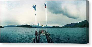 View Of Pier In Bay Of Water, Tierra Canvas Print by Panoramic Images