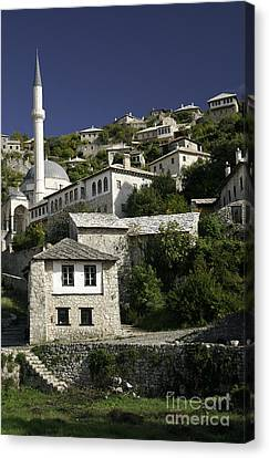 views of pocitelj in Bosnia Hercegovina with minaret bridge and river Canvas Print