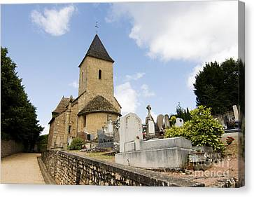 Village Church And Cemetery In France Canvas Print by Patricia Hofmeester