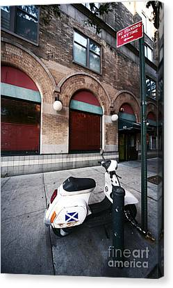 Village Scooter Canvas Print by John Rizzuto