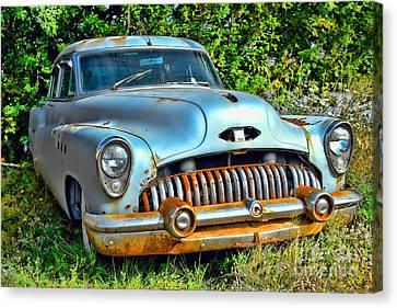 Vintage American Car In Yard Canvas Print by Olivier Le Queinec