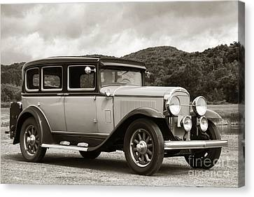 Vintage Automobile On Dirt Road Canvas Print by Olivier Le Queinec